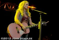 April 2012 Wisconsin Love her pink guitar and pink microphone !