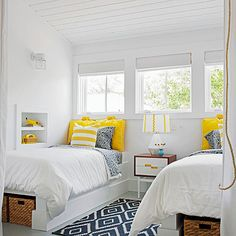 Add excitement to an all-white bedroom with trendy patterns and bright colors. Tour the rest of this coastal cottage: http://www.bhg.com/decorating/decorating-style/cottage/a-colorful-coastal-cottage/?socsrc=bhgpin050413blueyellowbedroom=10 coastal cottage, bedroom decor, guest bedrooms, color, white walls, decorating ideas, twin beds, guest rooms, bedroom designs