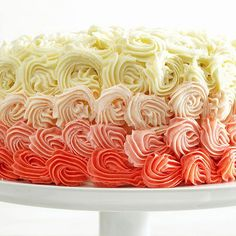Play dress-up with a plain-Jane cake by adding cascading rosettes of luscious white chocolate frosting: http://www.bhg.com/recipes/desserts/cakes/spring-cakes-and-cupcakes/?socsrc=bhgpin040214doublelayerwhitechocolatecake&page=3