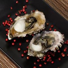 "Grilled Oyster Shooters | ""A cooked, nonalcoholic version of a well-known favorite, great as an appetizer."""