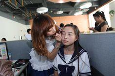 Doing her make up