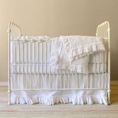 White crib bedding with tattered ruffle