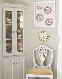 """Get """"Built-In"""" Dining Room Cabinets An unfinished wood corner cabinet saves money when a few deft decorating tricks are applied. Painted the same color as the dining room's walls, it gives the impression that it was built in and original to the house."""