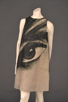 """""""Mystic eye"""" paper dress  Harry Gordon  1968  In March 1966, Scott Paper Company (now Kimberly-Clark) introduced a disposable paper dress called the """"Paper Caper"""" as a promotional tool. Available via mail-order for 1 and a quarter dollars.  The sleeveless, A-line mini dress was available in two patterns: red bandana print or black and white Op-Art print.  see ad here: http://blog.fidmmuseum.org/.a/6a01156f47abbe970c0120a57b4ba0970b-pi"""