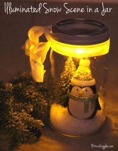 Illuminated Snow Scene in a Jar: You've seen snow scenes in mason jars, but have you ever seen one that's illuminated? It's done simply with a battery-operated tealight. Check out the tutorial to make your own! {BitznGiggles.com}