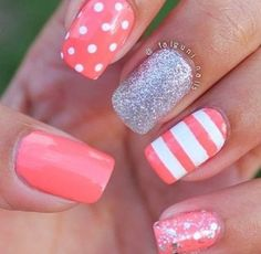 Pink patterns and a silver accent nail.
