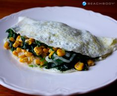 Try something a little different with this spinach and corn omelet sprinkled with flavorful smoked gouda cheese. #breakfast #cheese #eggs #high-protein #recipes #spinach