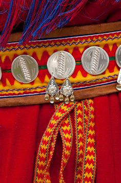 Lappland, Sweden. Bright colors and lots of fine silver detail are used on all the Sami folk costumes.
