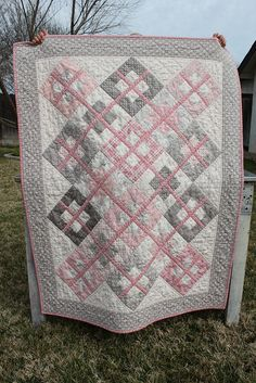 """Pink, gray, and cream baby quilt made with """"Puttin' On the Ritz"""" fabric by Moda. Pattern """"Baby Cakes"""" by Black Mountain Quilts"""