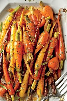 Formal: Orange-Ginger-Chile-Glazed Carrots | We've done the meal planning for you: take your pick from casual, classic, and formal Christmas Eve dinner menus. Whether your crowd prefers a casual holiday meal or a formal sit-down affair, we have menu ideas for every type of Christmas Eve dinner. Whichever menu you choose, these delicious dishes will put everyone in a festive mood.