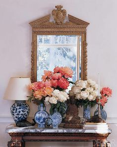 Blue ceramics with the coral and pink roses - gorgeous.   Michael S. Smith's Home