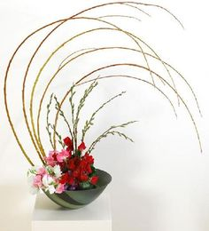 .Ikebana- japanese style of arranging  that typically only uses three flowers
