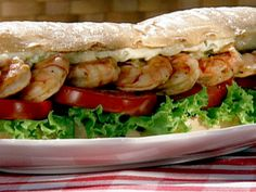 Food Network invites you to try this Grilled Shrimp Po' Boy recipe from Patrick and Gina Neely.