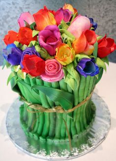 Rose Bouquet cake by Rosebud. Pipe green stems up the cake, and top with silk flowers on top. 'Tie' some twine or a ribbon around the cake and you have a bouquet!