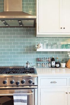 """Sneak Peek: Chelsea and Forrest Kline. """"We love the way the light works with the glass tile and the open shelves open things up and let us see more tile. The oven has delivered us many a pizza party, and for that we thank it."""" #sneakpeek"""