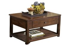 """The Marion Lift-Top Coffee Table from Ashley Furniture HomeStore (AFHS.com). With dark finishes and a rich contemporary design, the """"Marion"""" occasional table collection offers a unique style that is sure to enhance the living space of any home decor."""