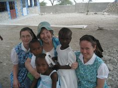 Hutterite women with Bettie Snyder, president of GLOW (God's Love for Widows and Orphans), in Haiti.
