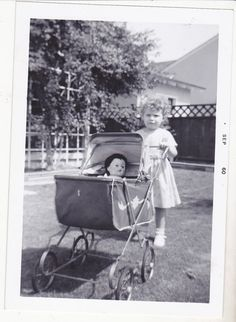 Vintage 1960's photo.Little girl with toy doll i
