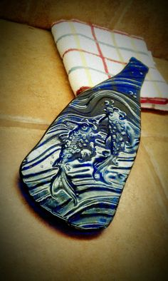 Melted bottle, Koi fish plate http://www.etsy.com/listing/84209169/recycled-melted-wine-bottle-koi-fish