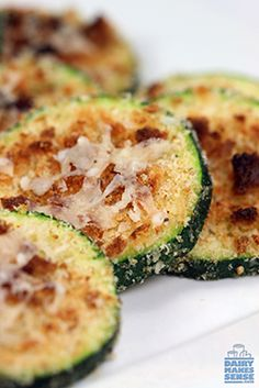 These Zucchini Parmesan Rounds are baked — not fried! — to golden cheesy perfection for a satisfying, healthy snack.
