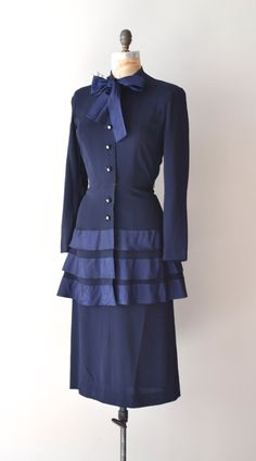 A timelessly pretty 1940s navy blue crepe dress with rhinestone buttons. #vintage #1940s #fashion