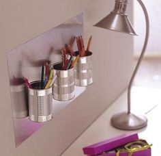 Wall pencil holder out of tin cans.