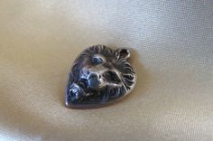 Vintage sterling silver lion heart charm for sale!