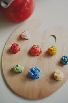 Easel with colored frosting for painting your own cupcakes