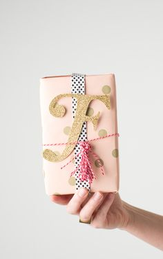 Add glittered monograms to packages.