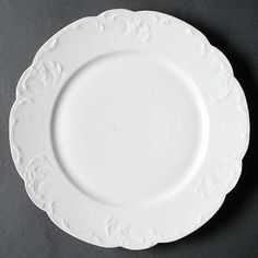 """Schleiger 7"" china pattern with scalloped edges and white Rococo inspired accents from Haviland."