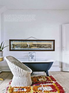 Who wouldn't love relaxing in this claw foot tub & enjoying the fantastic, custom framed #art piece above it?!?