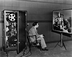 Producer Mervyn LeRoy watches a scene from his film at MGM.