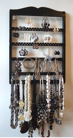 frame + wood strips + holes for earrings + cup hooks for necklaces = genius