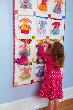 Quilt with pockets. Great idea for a little girl to put her treasures in.