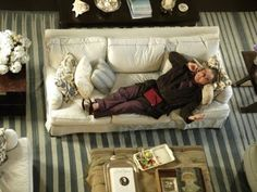 Harry reclining on Erica's sofa ~ I loved the white fabric & blue piping on this sofa ~  The blue & white striped cotton Dhurri rug was from The Rug Loft in NY.