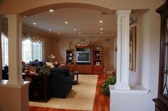 I want rough cut wood columns at the arched kitchen entrance