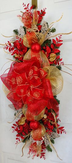 pics of deco swags | Christmas Swag Wreath | Deco Mesh - not necessarily these colors/floral, but I like the shape and style of this better than a wreath!