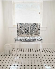 Kartell lucite chair in a bathroom.