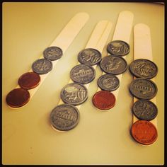 Kaboom! A great game to encourage coin counting. Just glue plastic coins to popsicle sticks and voila! You are ready to play!