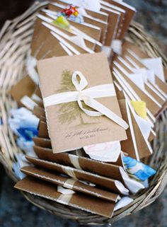 Wedding idea: Handmade wedding programs with vintage hankies (collected by bride and her mom) tucked inside