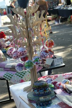 Headband display perhaps?  The decorated tree can be found here ... http://fionacarter.typepad.com/my_ramblings/2009/11/ribbons-galore-market-stall-photos.html