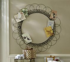 This Wreath Card Holder  from The Pottery Barn is a great way to display your incoming cards without having them take up a lot of surface room. It also makes a great gift!