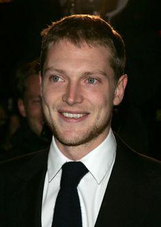 Simon Woods (born 1980) is an English actor. Partner(s): Burberry designer Christopher Bailey - Read more: http://en.wikipedia.org/wiki/Simon_Woods