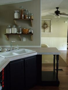 If she can get a trailer house to look this nice, surely there is hope for me!                  Small space kitchen.