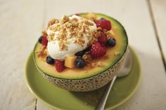 Melon filled with muesli, fresh berries and mascarpone cheese
