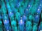 Glass With  Blue  Candles