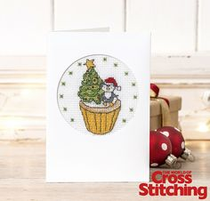 Cupcake of the Month - cross stitch pattern. For a French-knot-free, quick-make, go for the latest in our mouth-watering series of #cupcake designs by Durene Jones – a #Christmas penguin! Find it in our new issue 221 of The World of Cross Stitching magazine