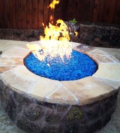 Love the blue glass in the fire pit