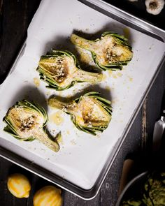 Roasted Lemon Garlic Artichokes at chasingdelicious.com. Recipe by @Russell Sese Sese Sese van Kraayenburg.