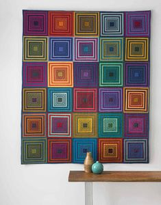 You won't believe how easy it is to make this modern quilt based on the log cabin pattern. By Tara Faughnan